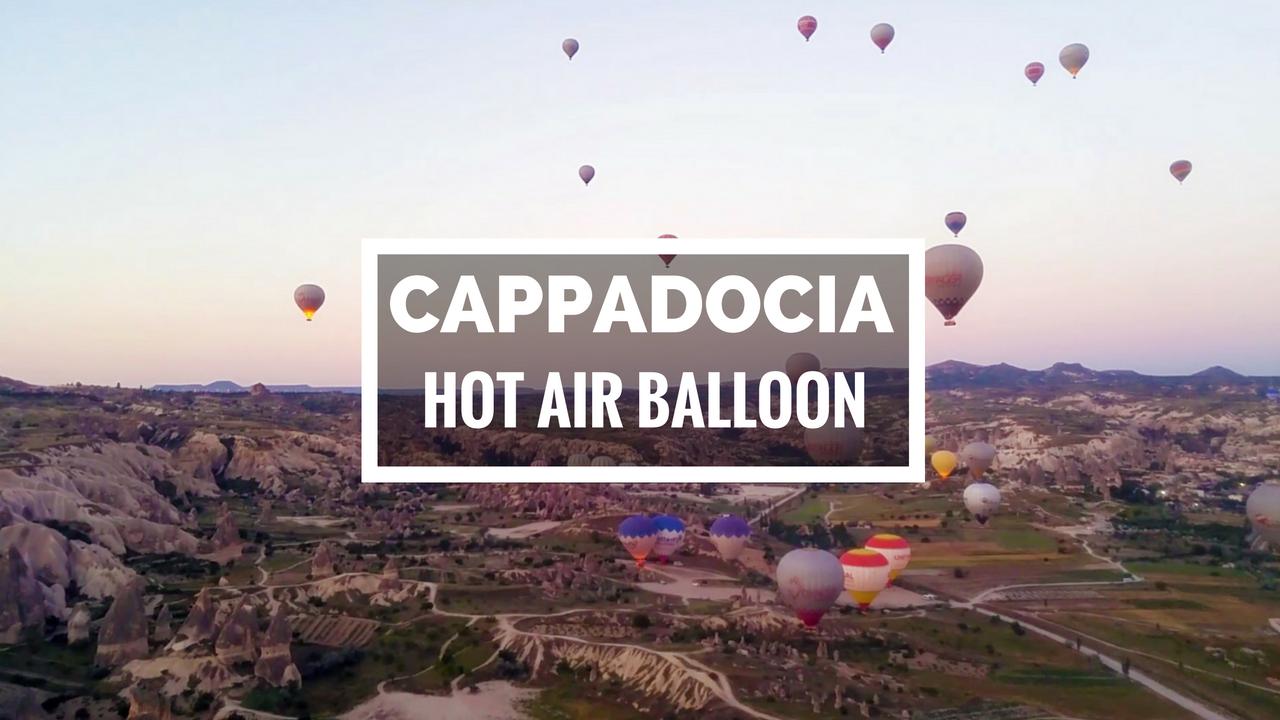 Dozens of hot air balloon over the landscape of Cappadocia, Turkey.